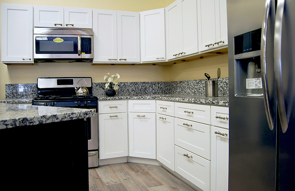 Tuscany white kitchen cabinets builders surplus for Builders warehouse kitchen cabinets